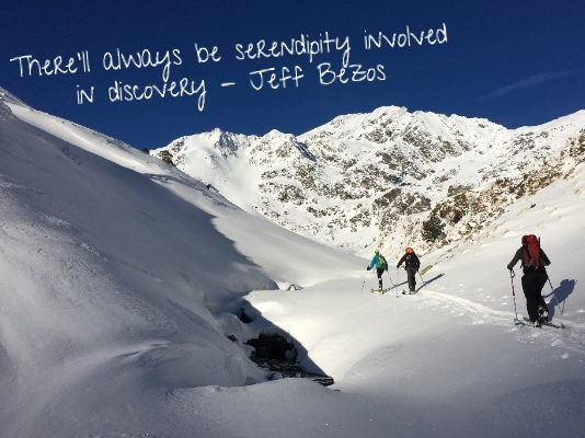 Photo of ski tourers approaching Font Blanca, with the quote: There'll always be serendipity involved in discovery - Jeff Bezos.