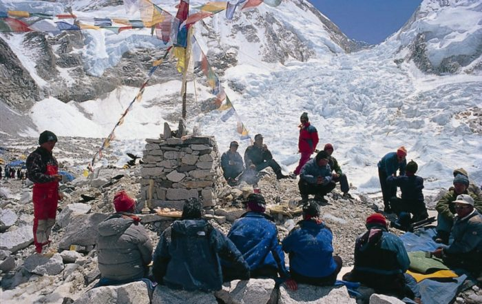 Sherpas holding a puja ceremony at basecamp