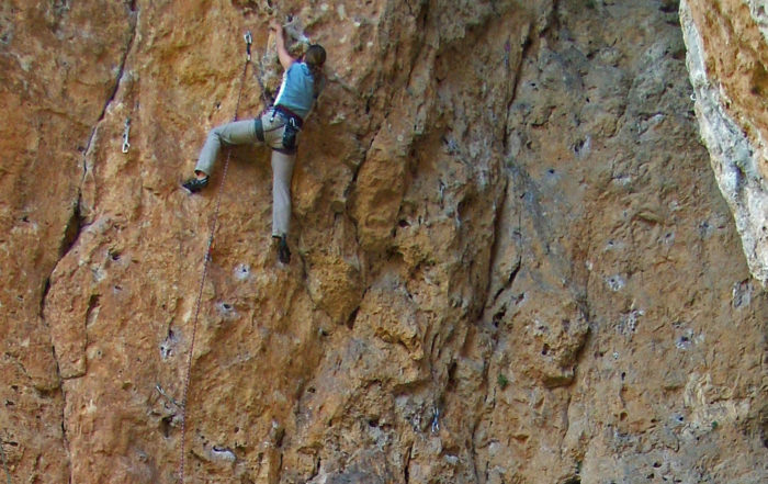 Cathy rock climbing
