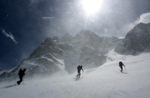 High winds batter our ski group as we climb.