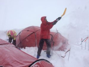 Mount Logan digging out in a storm