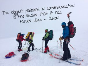 "The summit team of four about to head off into the mist. Text: ""The biggest problem in communication is the illusion that it has taken place"" -Anon"